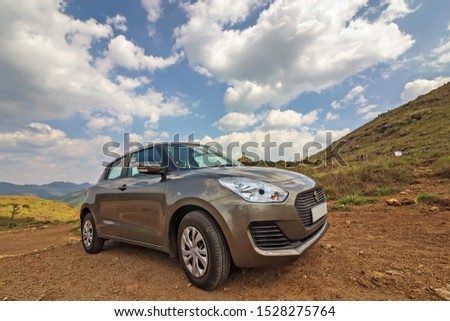 Travel concept car in beautiful nature mountain background. City : Ponmudi, Kerala -India. clicked on 02-Oct-2019 #1528275764