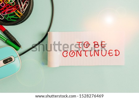 Handwriting text To Be Continued. Concept meaning indicate that the story continues in the next episode Notebook and writing equipment with computer mouse above pastel backdrop. #1528276469