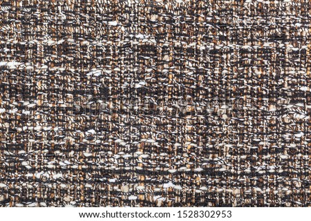 textile background - motley woven yarns of boucle fabric close up