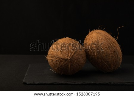 Coconut. Coconut isolated on black background. Full depth of field. Macro Photo food fruit coconut. Texture tropical fruit coconut nut. Image fruit coconuts. #1528307195
