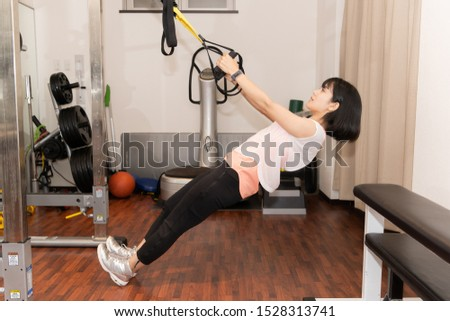 young woman in the gym #1528313741