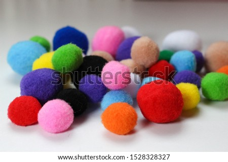 colorful pompom and white background  #1528328327