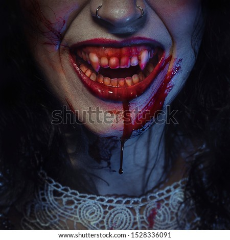 Vampire smile demon woman laughing with big fangs full of blood, image for halloween