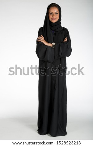 Arab middle eastern Saudi woman in traditional formal Abaya, on white isolated background, with different poses, expressions, hand and gestures, studio lighting ready for cutout and editing. #1528523213