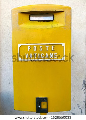 Cute mustard yellow mail box at the post office in Vatican City, Italy #1528550033