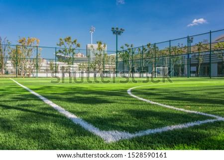 Panoramic view of soccer field stadium and stadium seats #1528590161