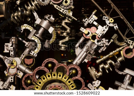 Different cogwheels in some mechanical device background #1528609022