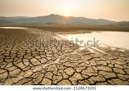 Drying lake effect of extreme weather and heating wave on summer, Climate change and Drought impact  Royalty-Free Stock Photo #1528671035