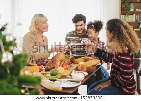 Happy Thanksgiving dinner party with family and food with turkey on table #1528738001