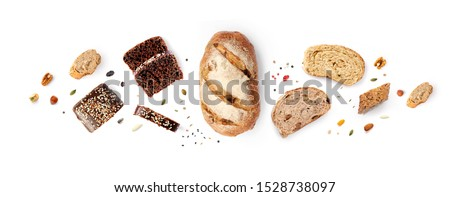 Creative layout made of breads on white background. Flat lay. Food concept. Royalty-Free Stock Photo #1528738097