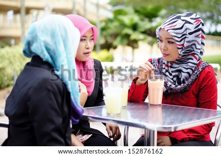 Muslim girl enjoy having conversation at restaurant #152876162