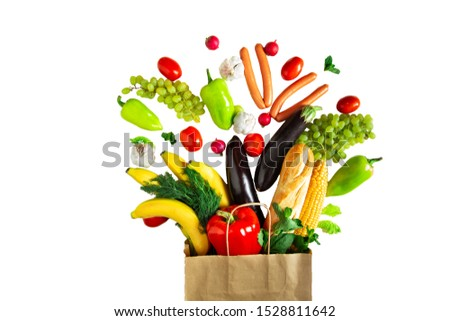 Eco-friendly paper bag full of various vegetables. Eco-friendly concept. Healthy eating concept. Isolated on white #1528811642