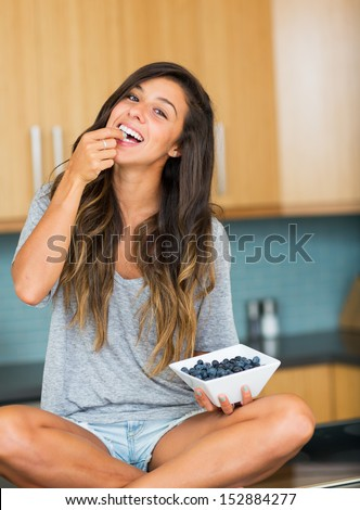 Beautiful woman eating blueberries, Healthy Food Lifestyle #152884277