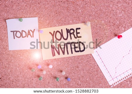 Handwriting text writing You Re Invited. Concept meaning Please join us in our celebration Welcome Be a guest Corkboard color size paper pin thumbtack tack sheet billboard notice board. #1528882703