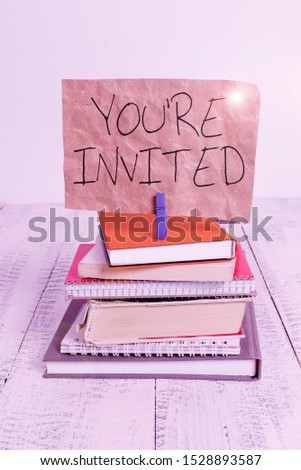 Writing note showing You Re Invited. Business photo showcasing Please join us in our celebration Welcome Be a guest pile stacked books notebook pin color reminder white wooden. #1528893587