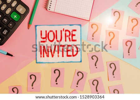 Writing note showing You Re Invited. Business photo showcasing Please join us in our celebration Welcome Be a guest Mathematics stuff and writing equipment above pastel colours background. #1528903364