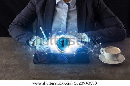 Business woman working on tablet with secured cloud technology and network concept #1528943390