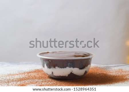 Pudding with chocolate mixture and biscuits in it #1528964351