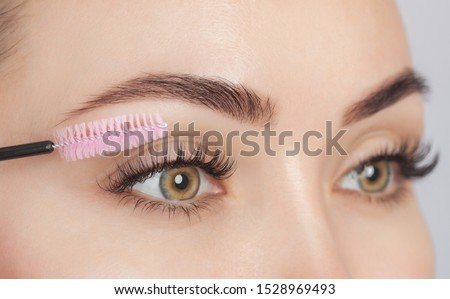 Beautiful Woman with long eyelashes in a beauty salon. Eyelash extension procedure. Cosmetology skin care Royalty-Free Stock Photo #1528969493