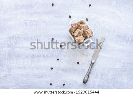 Flavored Halva pieces top view or overhead view composition with copy space #1529015444