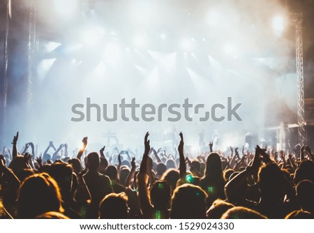 crowd at concert and stage lights with space for text #1529024330