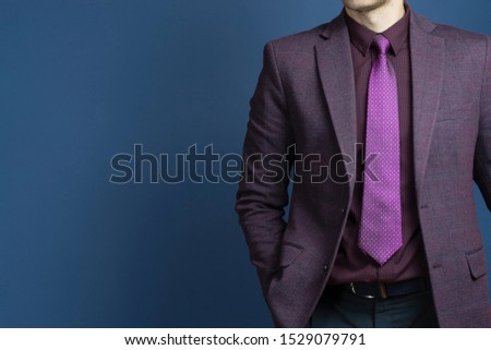Close up of businessman in purple suit confident on blue background #1529079791