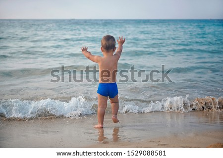 Image result for little boy running towards the lake