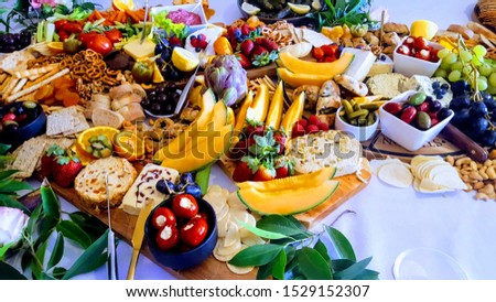 Grazing table with meats fruit cheese  Royalty-Free Stock Photo #1529152307