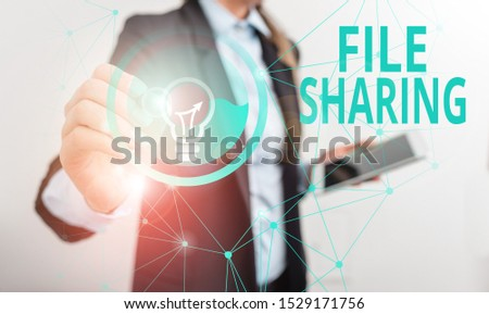 Conceptual hand writing showing File Sharing. Business photo showcasing transmit files from one computer to another over a network Male human wear formal suit presenting using smart device. #1529171756