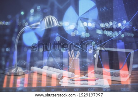 Stock market graph and table with computer background. Double exposure. Concept of financial analysis. #1529197997