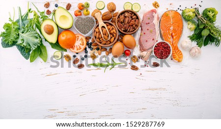 Ketogenic low carbs diet concept. Ingredients for healthy foods selection on white wooden background. Balanced healthy ingredients of unsaturated fats for the heart and blood vessels. #1529287769