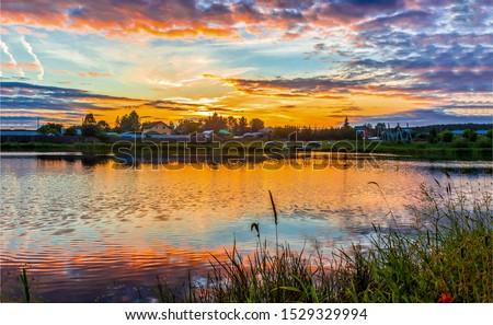 Sunset rural river landscape. Village river sunset landscape. Sunset river village view. Sunset village river landscape #1529329994
