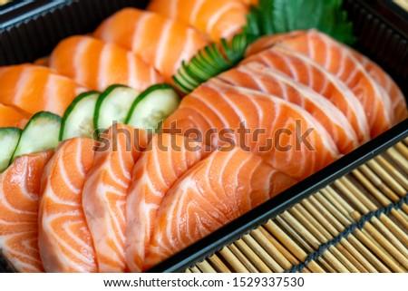 fresh salmon are sushi and sashimi - Japanese food style #1529337530