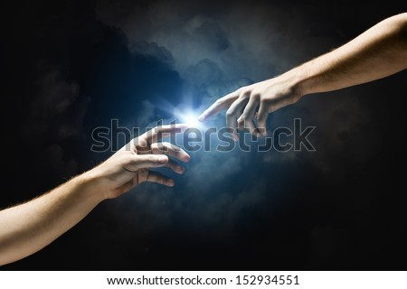 Michelangelo God's touch. Close up of human hands touching with fingers Royalty-Free Stock Photo #152934551