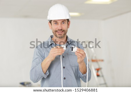 a man is connecting cables