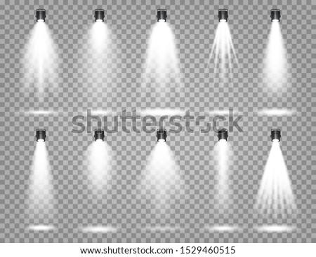 Vector spotlight set. Bright light beam. Transparent realistic effect. Stage lighting. Illuminated studio spotlights. Royalty-Free Stock Photo #1529460515