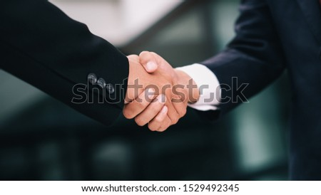 Businessmans handshake. Successful businessmen handshaking after good deal. Business partnership meeting concept. #1529492345