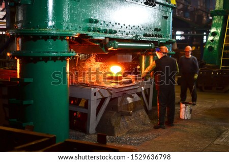 Blacksmith processes the red hot iron under a huge press. Metal forging, stamping under hammer forge at workshop of forge foctory. Blacksmithing, metallurgical, steelmaking, hot rolling mill #1529636798