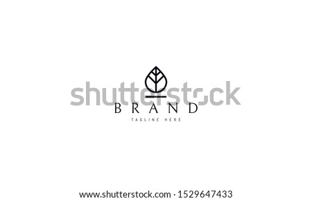 Vector logo on which an abstract image of a drop of water which is also similar to a leaf of a tree. Royalty-Free Stock Photo #1529647433