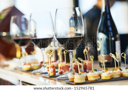 catering services background with snacks and glasses of wine on bartender counter in restaurant Royalty-Free Stock Photo #152965781