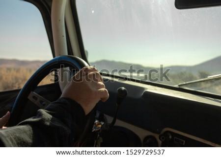 Man Driving a Car Off Road #1529729537