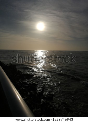 this is natural pic of thiruchendur beach sunlight. In this is pic evening time sun light is fall under the ocean