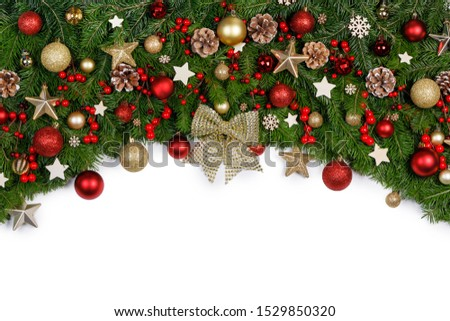 Christmas Border frame of tree branches on white background with copy space isolated, red and golden decor, berries, stars #1529850320