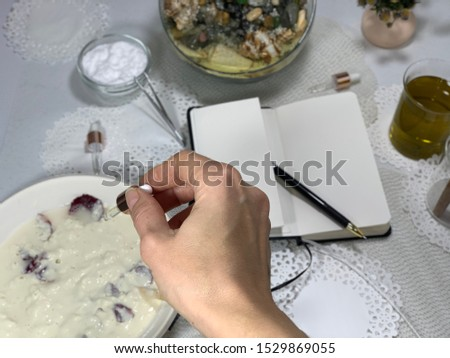 Dripping oil in a pipette. Oil in a pipette. Medicinal herbs. Starch, flour with bran in a plate. Notebook with pen, write down the recipe. Home cosmetology. #1529869055