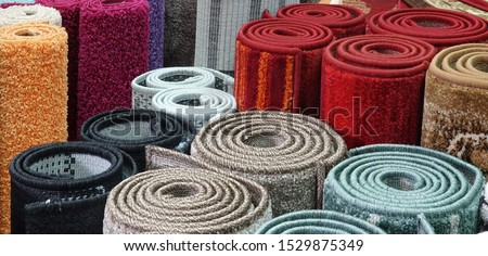 Carpets variety selection rolled up rugs shop store Royalty-Free Stock Photo #1529875349