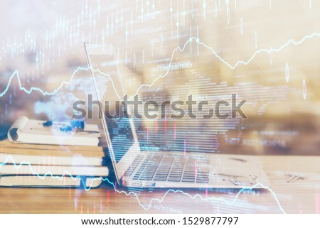 Stock market chart hologram drawn on personal computer background. Double exposure. Concept of investment. #1529877797