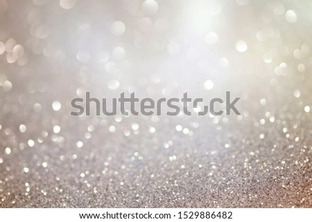 Silver glittering christmas lights. Blurred abstract background #1529886482