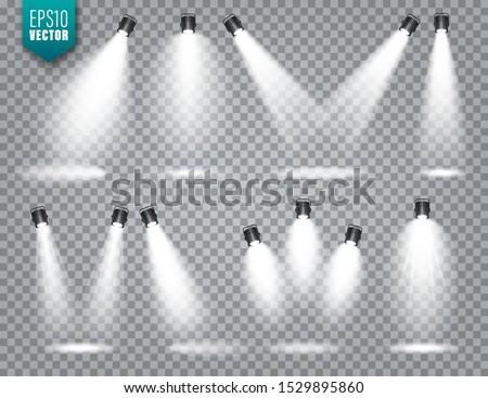 Vector spotlight set. Bright light beam. Transparent realistic effect. Stage lighting. Illuminated studio spotlights. Royalty-Free Stock Photo #1529895860