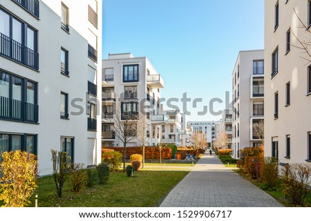 Modern apartment buildings in a green residential area in the city Royalty-Free Stock Photo #1529906717