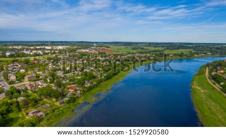 Aerial view from flying drone over the  Jekabpils city (Latvia) #1529920580
